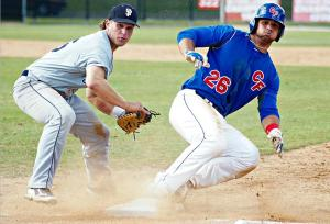 Khawam sliding into first base