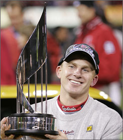 Eckstein holding World Series MVP trophy in 2006