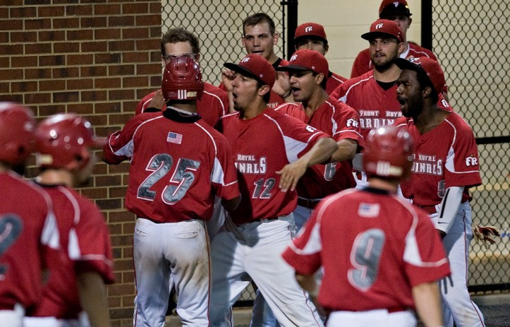 Valentin (#12) greets his teammates after a bases-clearing double  (Rich Cooley/Daily)