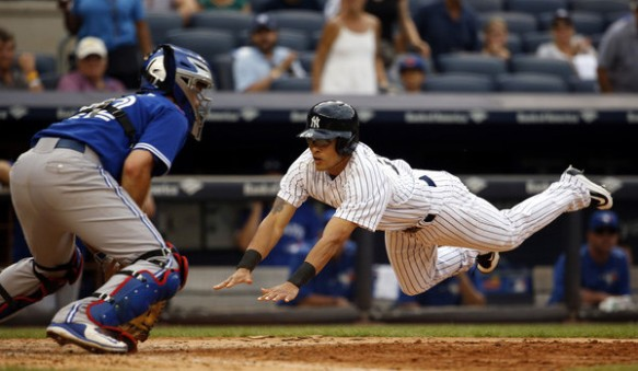 rico-noel-diving-into-home-yankees