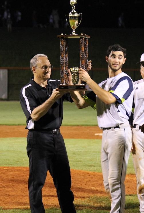 Michael Wielansky hoisting trophy 2017